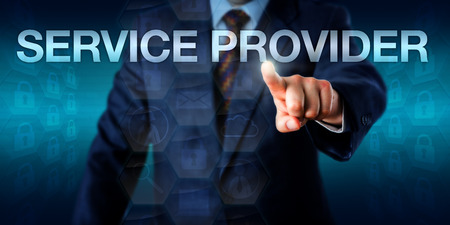 Male IT professional is touching the word SERVICE PROVIDER onscreen. Business and technology concept for managed service provider, application service provider and network service provider. Фото со стока