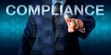 conform: Manager is touching the word COMPLIANCE in cyberspace. Business concept and technology metaphor for compliance with corporate policies, procedures, standards and regulations.