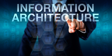 structuring: IT consultant is touching the words INFORMATION ARCHITECTURE onscreen. Business metaphor for the structuring of shared information environments, database development and information engineering.