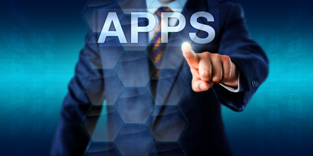 application software: Entrepreneur is touching the word APPS in cyberspace. Technology background and business concept for application software, mobile apps and web applications performing tasks for the benefit of users. Stock Photo
