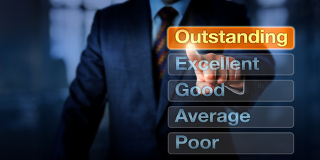 performance appraisal: Manager is selecting Outstanding atop five buttons, followed by Excellent, Good, Average and Poor. Business concept for career development discussion and performance appraisal, evaluation or review. Stock Photo