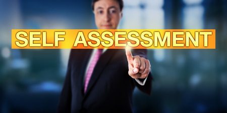 oneself: Happy manager pressing SELF ASSESSMENT on a touch screen interface. Business metaphor and applied psychological concept for self-assessment or self-evaluation and the process of looking at oneself. Stock Photo