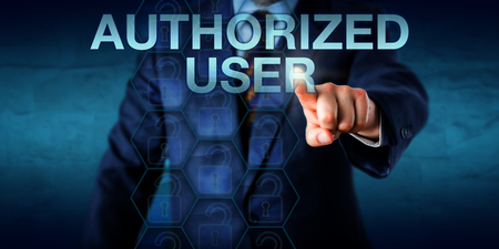 access restricted: Business manager is pressing AUTHORIZED USER on a touch screen interface. Technology concept for a corporate user with security clearance and granted authority to access restricted information.