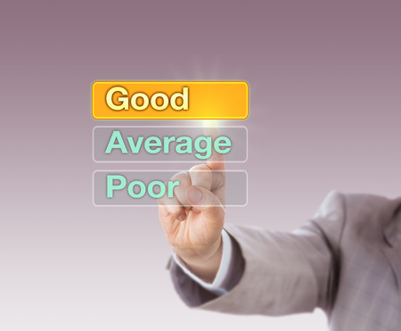 appraisal: Arm in light gray suit is choosing GOOD atop three buttons, followed by Average and Poor. Business concept for performance appraisal, short PA, career development discussion and self assessment. Stock Photo