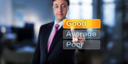 Smiling Human Resources manager selecting GOOD atop three option buttons, followed by Average and Poor. Business concept of performance appraisal, short PA, or employee appraisal and self assessment.