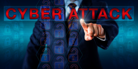 offensive: White collar hacker touching the warning CYBER ATTACK onscreen. Technology and business concept for offensive acts targeting critical computer information systems and computer networks in cyberspace. Stock Photo