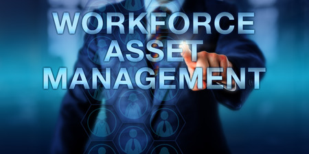 technology metaphor: Male manager is touching WORKFORCE ASSET MANAGEMENT on a virtual screen. Male and female employee icons display in a hexagonal matrix. Business concept and technology metaphor. Copy space.