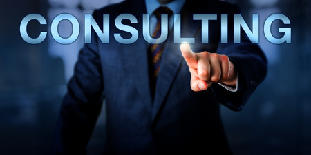 Male management consultant is pushing CONSULTING onscreen. Business concept for services providing professional business advice or expertise in a specific field, such as security, marketing or law.