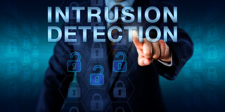 intrusion: Security expert is pushing INTRUSION DETECTION on a touch screen interface. Three opened lock icons among otherwise locked virtual padlocks are highlighted. Technology and business concept. Stock Photo