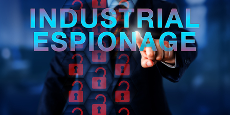 corporate espionage: Competitor is pushing INDUSTRIAL ESPIONAGE on a touch screen interface. A stream of virtual, unlocked padlock icons are lighting up red to signify a security breach. Technology and industry concept.