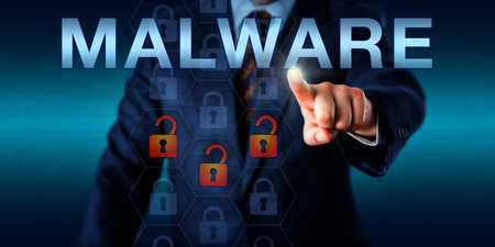 contaminant: Management consultant touching MALWARE onscreen. Three opened padlock icons light up in fiery colors to signify a malicious disruption, virus attack or embedded trojan horse. Technology concept. Stock Photo