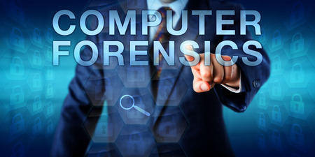 computer crime: Forensic expert is pressing COMPUTER FORENSICS onscreen. A virtual magnifying glass icon is hovering over locked hexagonal data packets. Technology concept for an investigation into computer crime.
