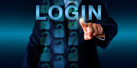 Corporate user is pushing LOGIN on a touch screen interface. He is identifying himself via fingerprint with his index finger. Security technology concept for authorized computer and network access.
