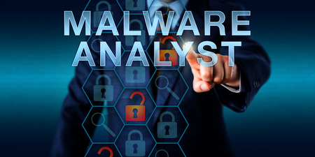 identifying: Security director touching MALWARE ANALYST onscreen. Security technology concept for a corporate analytical role in cybersecurity responsible for identifying and analyzing malicious program threats.