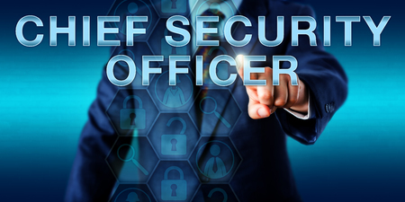 continuity: Corporate executive pushing CHIEF SECURITY OFFICER onscreen. Technology concept for a senior management team role in information security, business continuity planning, auditing and risk management.