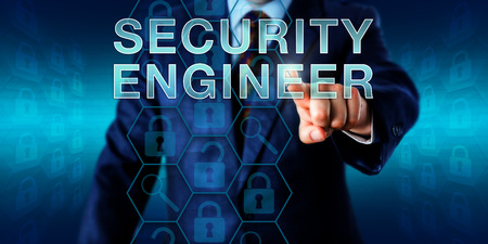business roles: Corporate recruitment manager is pressing SECURITY ENGINEER onscreen. Technology metaphor and business role concept for a mid-level employee maintaining corporate IT security systems. Copy space.
