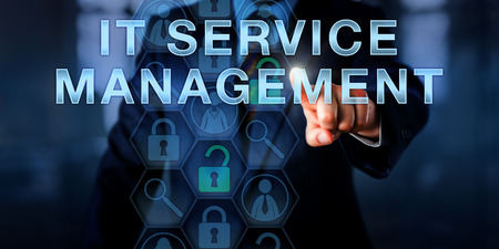service: Manager is pushing IT SERVICE MANAGEMENT on a touch screen. Technology concept and business metaphor for information technology service management. Copy space over office interior background. Stock Photo