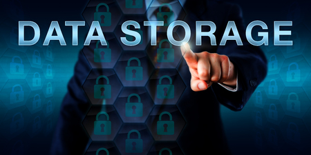 storage: Database manager is pushing DATA STORAGE on a touch screen interface. Technology and business concept. Many locked padlock icons embedded in a hexagonal structure do represent reliable data storage.