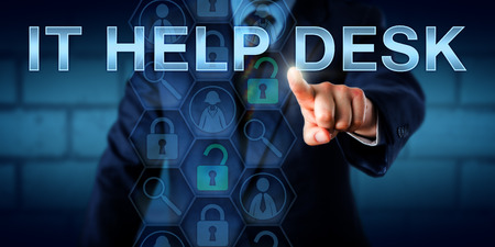 Corporate user is touching IT HELP DESK on a touch screen interface. Business concept for the information technology support industry troubleshooting problems and providing assistance to customers.