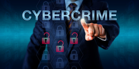 corporate espionage: Crime investigator pushing CYBERCRIME onscreen. Business metaphor and technology concept. Three red unlocked padlock icons do represent a security breach, hacking attempt or compromised information. Stock Photo