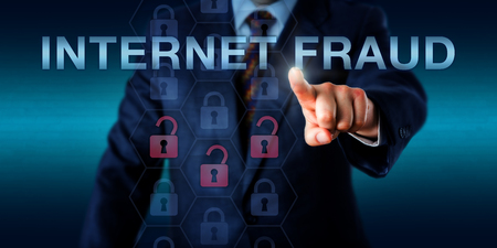 fraudulent: Merchant is pushing INTERNET FRAUD on a touch screen interface. Business metaphor and security technology concept for identity theft, fraudulent transactions and fake work-at-home schemes.