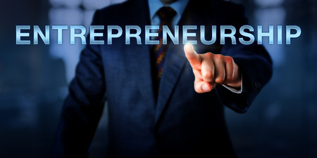 buzz word: Innovator is touching ENTREPRENEURSHIP on a virtual screen. business metaphor and concept for a positive attitude towards risk-taking and the process of launching and developing a new business. Stock Photo