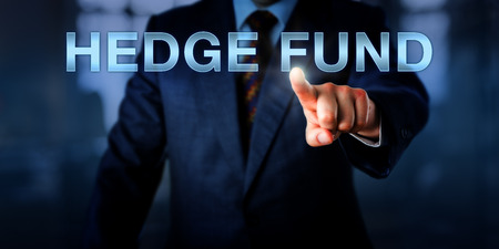administered: Portfolio manager is pointing at HEDGE FUND on an interactive touch screen. Financial metaphor and business concept for an investment vehicle for liquid assets administered by a management firm.
