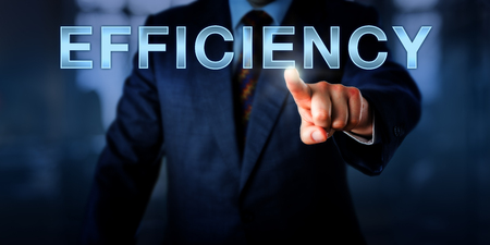 capitalized: Male industrial manager pushing the capitalized word EFFICIENCY on a touch screen interface. Business concept for the ability to do things well, while minimizing waste of time, energy or resources.