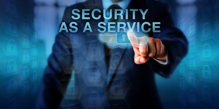 Content owner is pushing SECURITY AS A SERVICE on a touch screen. Business metaphor and computer technology concept for the integration of security services delivered by a cloud service provider. Stock Photo
