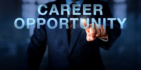 continued: Male recruiter is pushing CAREER OPPORTUNITY onscreen. Business concept for continued professional development, occupational choice, workplace change and management of individual progress. Stock Photo