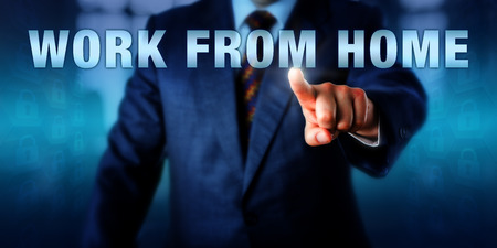 freelancing: Entrepreneur is pushing WORK FROM HOME on a touch screen. Business metaphor and technology concept for freelancing, short-term or temporary contractor work, minijobber, outsourcing and offshoring. Stock Photo