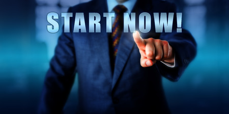 buzzword: Entrepreneur is touching START NOW! on a virtual screen. Business metaphor and coaching concept for taking initiative, embracing change, advancing career, launching new business and goal setting.