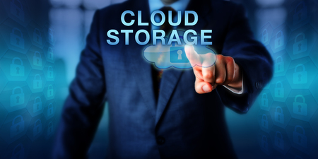 scalability: Service provider is pushing CLOUD STORAGE on a touch screen interface. Business services metaphor and technology concept for secure data storage via remote servers with a virtualized infrastructure. Stock Photo