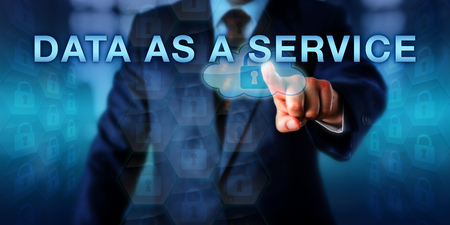 virtualization: Solution provider pressing DATA AS A SERVICE on a touch screen interface. Business and technology concept for data as a product being provided on demand via the virtualization from remote locations.