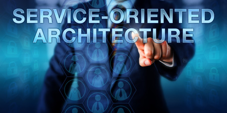 System designer is pushing SERVICE-ORIENTED ARCHITECTURE on a touch screen interface. Business metaphor and information technology concept for service software designed in an architectural pattern.