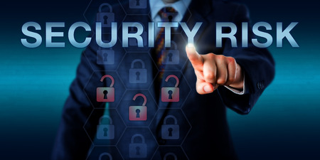 flaw: Management executive is touching SECURITY RISK on a screen. Business metaphor and technology concept for any potential security threat, compromised data access or identification of security flaw. Stock Photo