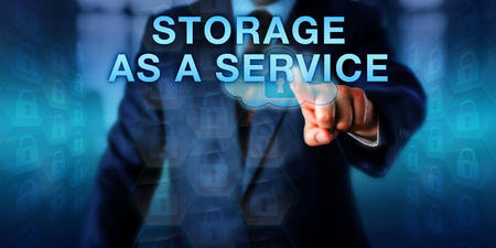 storage: Virtual architect touching STORAGE AS A SERVICE on an interactive screen. Business model metaphor and information technology concept for offsite backup via the infrastructure of a service provider.