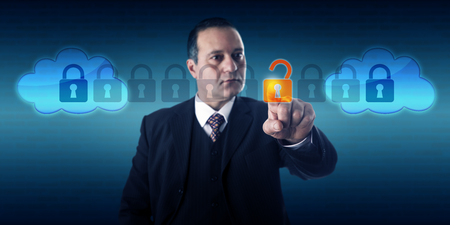 interoperability: Highly focused businessman is unlocking a data packet within an intercloud information stream. Technology management, internet security, service provider interoperability and cloud computing concept.
