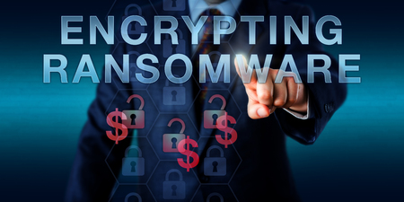 ransom: Infected computer user is pressing ENCRYPTING RANSOMWARE on a touch screen interface. Cyber security and information technology concept for malicious software extorting ransom money. Stock Photo
