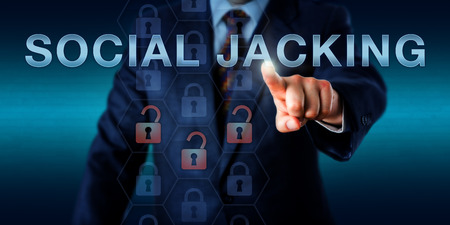 malicious: White collar criminal is touching SOCIAL JACKING on a virtual screen. IT risk and information technology security concept for a malevolent technique and malicious software tricking the internet user. Stock Photo