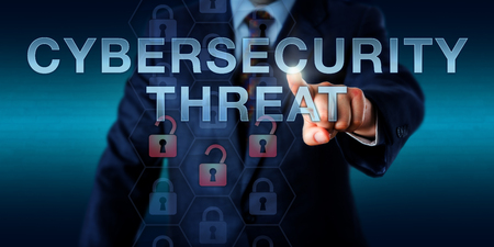 threat: Enterprise user is pushing CYBERSECURITY THREAT on a touch screen interface. Information security concept for a vulnerability, software flaw or system susceptibility exposed to a cyber attack.