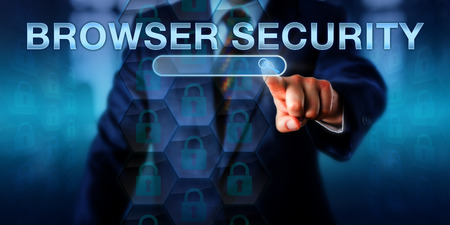 internet user: Business internet user is pushing BROWSER SECURITY on a touch screen interface. Business metaphor and information technology concept for internet security applied to web browser applications. Stock Photo