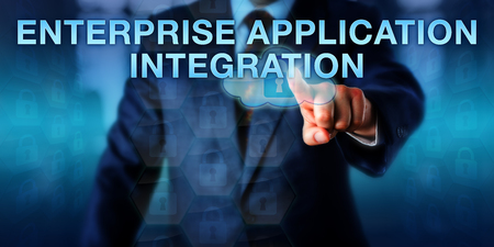 middleware: Software engineer touching ENTERPRISE APPLICATION INTEGRATION on a screen. Business model and information technology concept for integration of applications and automation of business processes.
