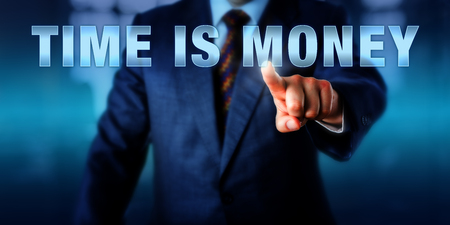 yielding: Businessman is touching the phrase TIME IS MONEY on a virtual screen. Business catch phrase and financial concept for the investment of labor hours yielding a monetary return or economic benefit.