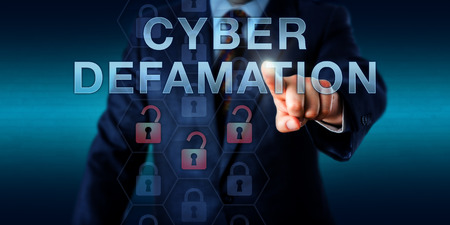 Legal consultant is touching CYBER DEFAMATION on a virtual interface. Information technology concept for defamation via malicious online commentary in forums, websites and internet portals.