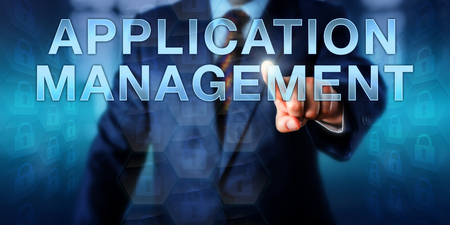 approach: Corporate manager is pressing APPLICATION MANAGEMENT on a touch screen interface. Business concept for data management, managed service, network support and an approach to outsourced management.