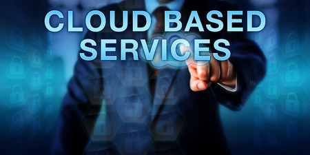 cloud based: Enterprise manager is touching CLOUD BASED SERVICES on a virtual screen. Information technology concept and business strategy metaphor for integrating IT resources with applications in the cloud.