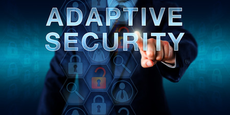 adaptive: Network supervisor is touching ADAPTIVE SECURITY onscreen. Business metaphor. Information technology and security concept for secure network control protecting enterprises against advanced threats. Stock Photo