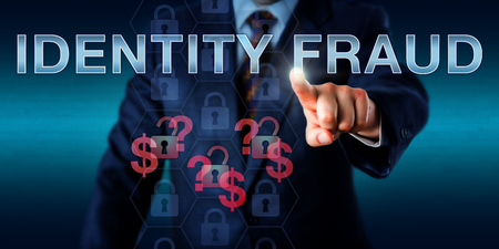 fraudster: Cyber fraudster is touching IDENTITY FRAUD on a virtual screen. Information technology and security concept for white collar crime of using stolen personal information for online procurement.