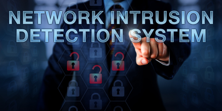 intrude: Administrator is pushing NETWORK INTRUSION DETECTION SYSTEM on a touch screen interface. Business metaphor and information technology concept for software monitoring a computer network for attacks.